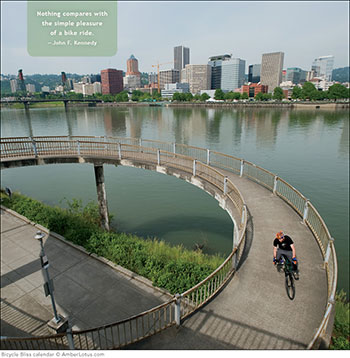 Cycling is a popular and earth-friendly activity in Portland. This image from the Bicycle Bliss 2015 wall calendar features Portland in the background.